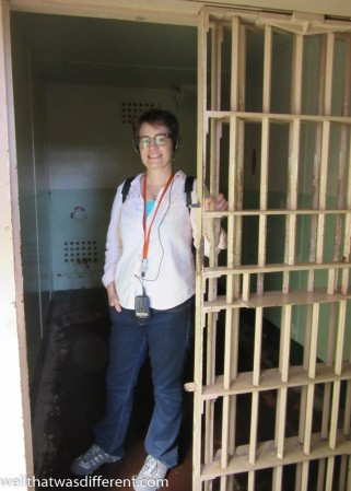 Inside a solitary confinement cell with dorky audio tour headphones.