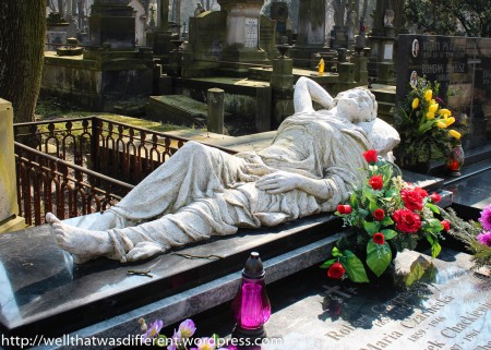 Possibly the most cheerful grave I've ever seen. Lovely statue with a smile on her face.