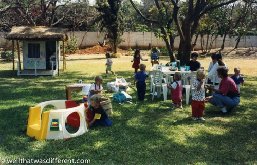 The playgroup in action in my enormous front yard. My husband hired a guy to build the playhouse out of packing crates.