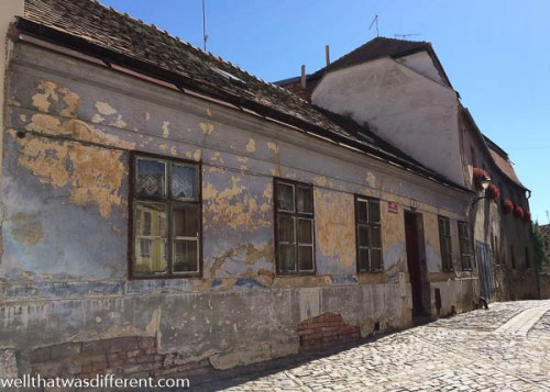 This is what every small Czech town looked like when we lived in Prague. Now, the one shabby house stands out on the street.