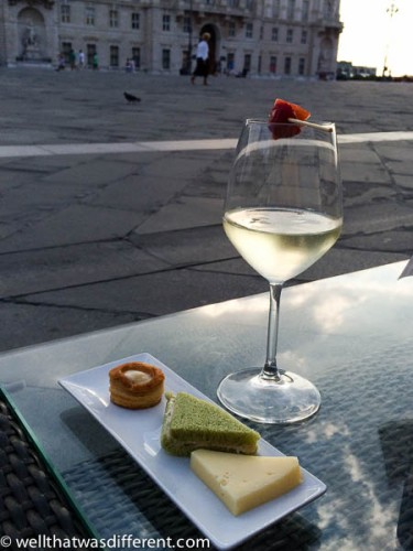 Prosecco and tramezinni on the Piazza. Right before a seagull snatched the pastry thing!