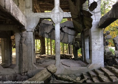 Bombed-out barracks in the woods.