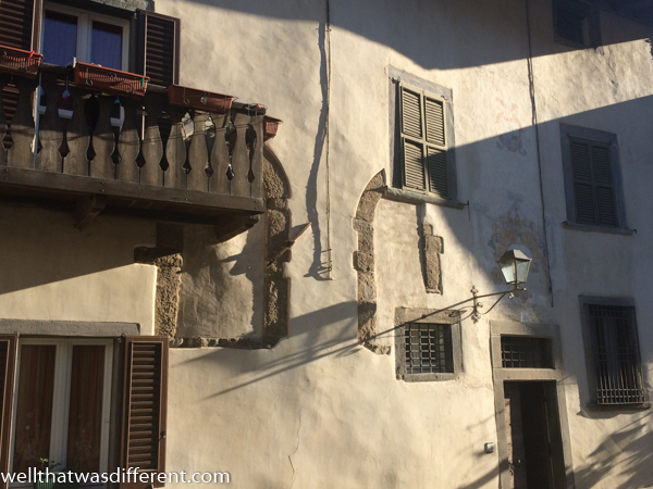 I love how you can see the traces of older buildings in so many walls in Italy.